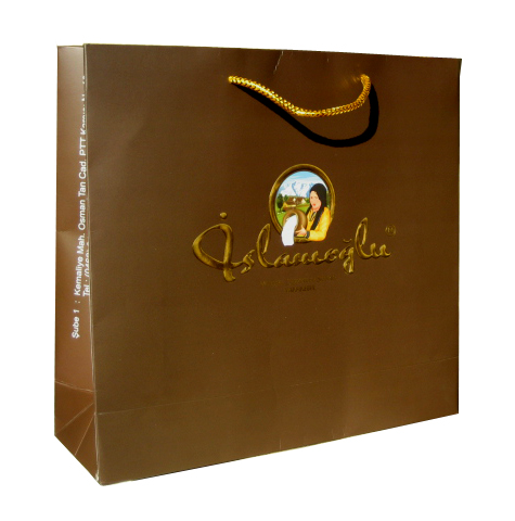 230 gsm Art Paper + 4 colour Photographic Print + Matt Lamination + Logo Embossing + Gold Foil Stamp + Gold Metalic Macrome Handle