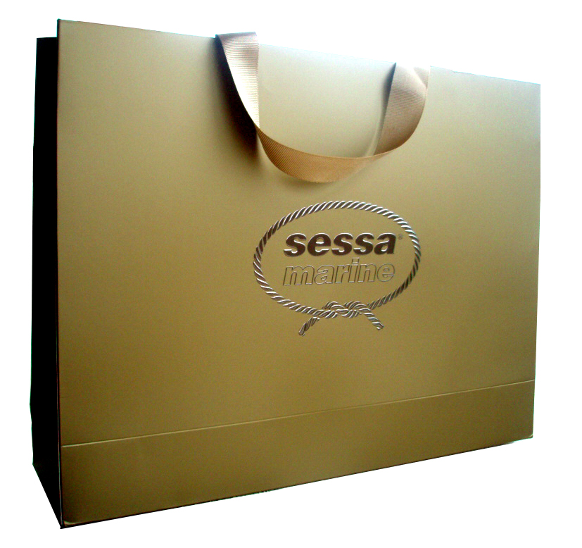 300 gsm Art Paper + Metallic Gold Printing + Matt Lamination + Silver Foil Stamp + Logo Embossing + Ribbon Handle